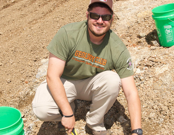 In April 2015, Wesley Weisberg (2014) collects samples in the Wet Mountains of Colorado to continue the research project he started during his first summer as a RESESS intern. (Photo/Aisha Morris, UNAVCO)