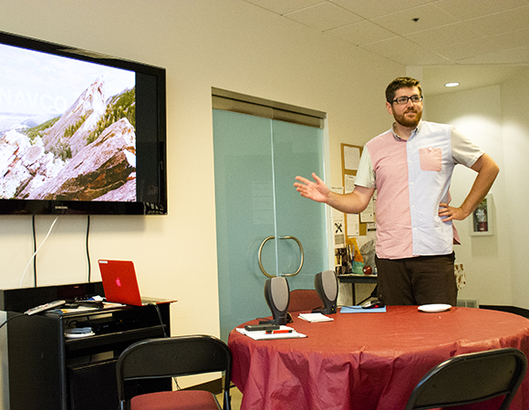 USIP intern Andrew Bayles shares his work producing videos with the UNAVCO Education and Community Engagement program at the USIP wrap-up for UNAVCO staff. (Photo/Beth Bartel, UNAVCO)