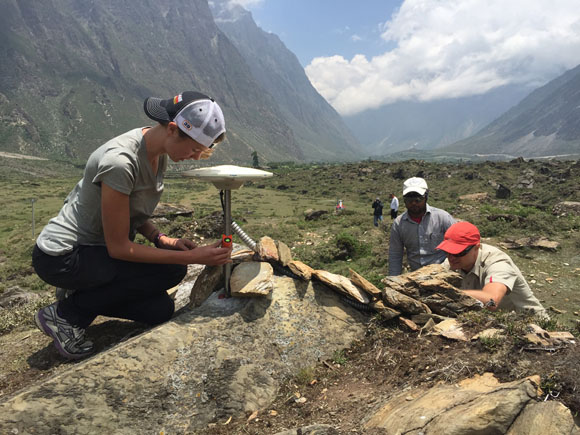 Installation of GPS Station TSM1 in Tsum Valley, Nepal. Pictured are Ellen Knappe (foreground), University of Montana, Michael Fend (right), UNAVCO and Ratna Mani Ghupta, DMG (left) on June 11, 2015. Credit: John Galetzka, UNAVCO