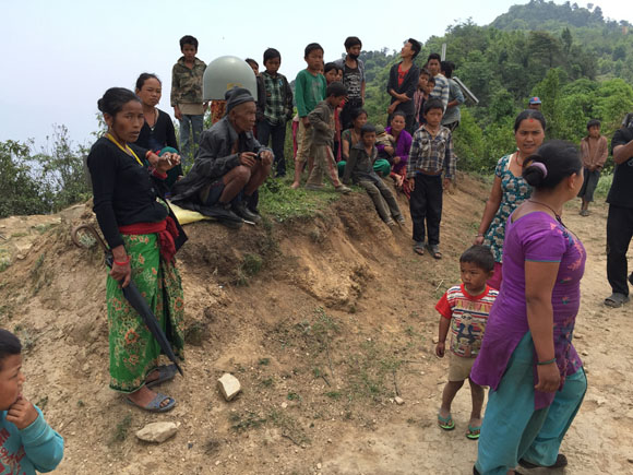 Data download at GPS station SNDL in Nepal, while locals watch around the antenna. Photo: John Galetzka, UNAVCO, May 25, 2015