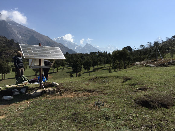 Working at GPS station SYBC with Mount Everest in the background. Photo: John Galetzka, UNAVCO, May 25, 2015