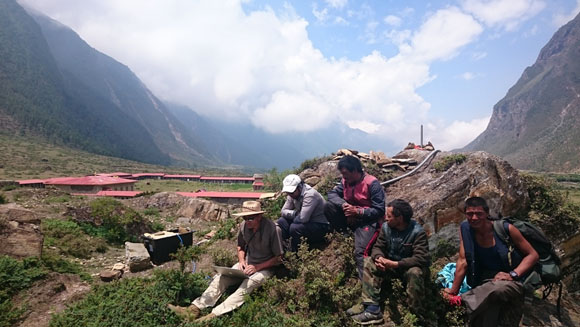 From left to right John Galetzka, UNAVCO and Ratna Mani Ghupta, DMG configuring the Trimble NetR9 for GPS station TSM1 in Tsum Valley, Nepal. Photo: Michael Fend, UNAVCO June 11, 2015