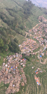 Damage to village in Nepal after the Gorkha, Nepal earthquake and Mw 7.3 12 May 2015 aftershock. Photo taken from a helicopter by John Galetzka, UNAVCO on May 19, 2015