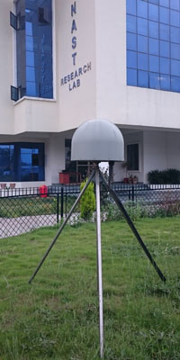 GPS station named NAST is located in the center of Kathmandu Valley, Nepal. Close-up of antenna. Photo: Michael Fend, UANVCO, May 11, 2015