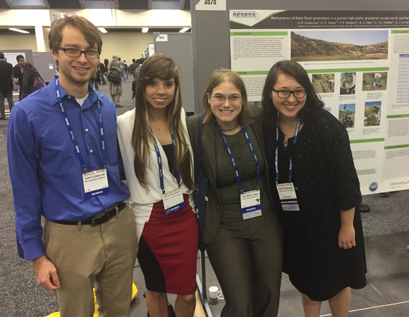 2014 interns Garth Ornelas, Ashlyann Arana Morales, Ann Marie Prue and Amy Asanuma attend a poster session at the annual AGU Fall Meeting. (Photo/Aisha Morris, UNAVCO)