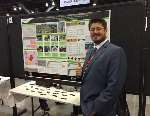Wesley Weisberg (2014 intern) presents his poster on Thermochronology of the McClure Mountain Syenite at the GSA Annual Meeting. (Photo/Aisha Morris, UNAVCO)