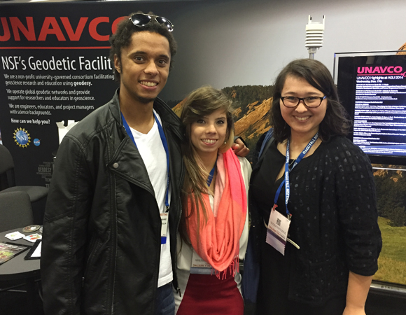 RESESS alum Nathan Mathabane and 2014 interns Ashlyann Arana Morales and Amy Asanuma enjoy time at the UNAVCO Exhibit Booth during the annual AGU Fall Meeting. (Photo/Aisha Morris, UNAVCO.)