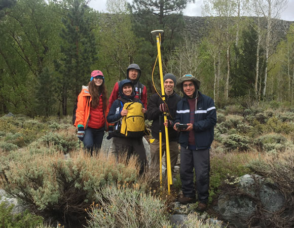 Rain or shine, it\'s survey time! (Photo by Beth Bartel, UNAVCO)