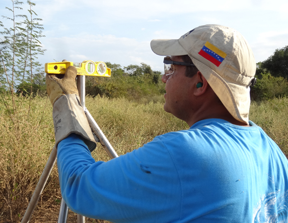 Ricardo Lopez of FUNVISIS checks level of the short drilled-braced monument for station CN39. (Photo/Franck Audemard)