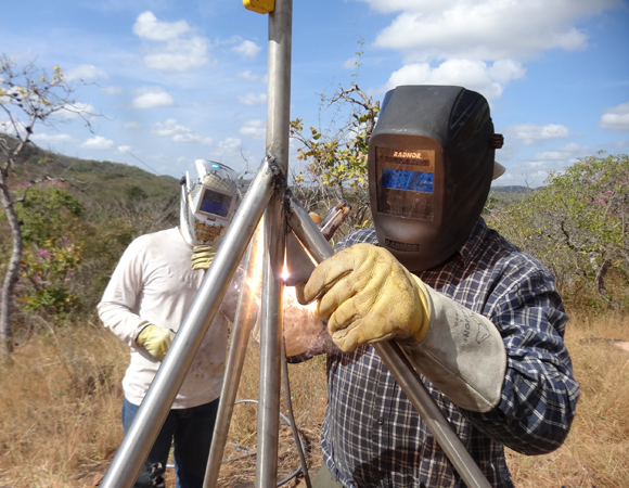 UNAVCO field engineer John Sandru works on welding the monument for CN41. Others also participated. A primary goal of installations in Venezuela is knowledge transfer. (Photo/Franck Audemard)