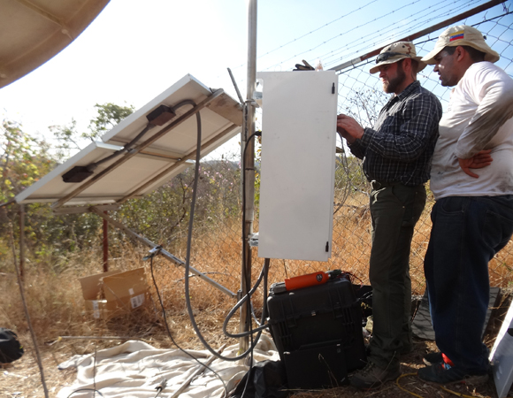 Field engineer John Sandru of UNAVCO and Ricardo Lopez of FUNVISIS configure the GPS receiver for station CN41. (Photo/Franck Audemard)