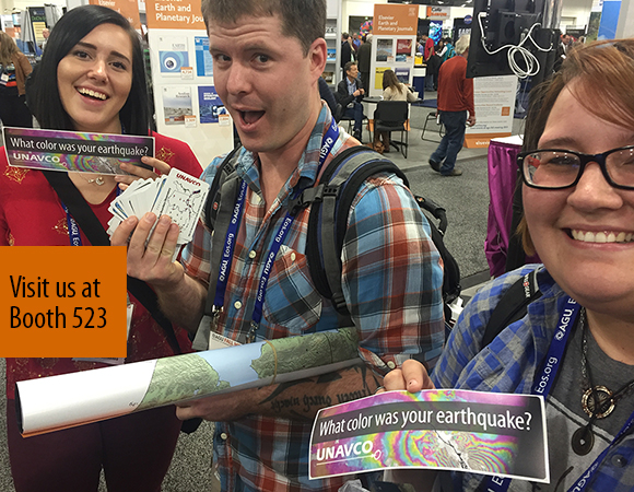 Happy recipients of UNAVCO geodesy bumper stickers, posters, and playing cards at AGU 2015. (Photo/Beth Bartel, UNAVCO)