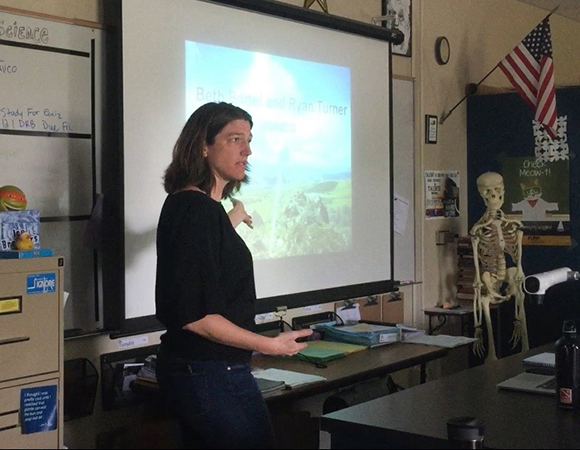 UNAVCO outreach specialist Beth Bartel discusses geodesy research and instrumentation with students at Olga Reed Elementary School. (Photo by Ryan Turner, UNAVCO)