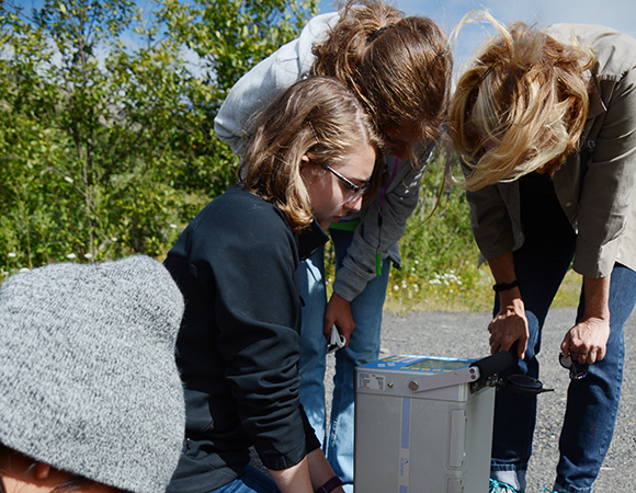 Geodesy day: GeoGirls try their hands at making gravity measurements in a transect from the Coldwater Science and Learning Center to the Johnston Ridge Observatory, led by USGS geophysicist Evelyn Roeloffs. (Photo/Beth Bartel, UNAVCO)