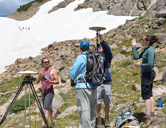 Polar field engineers Spencer Niebuhr (far left) and Annie Zaino (far right) lead Geo-Launchpad interns in a GPS survey at St. Mary\'s Glacier, Idaho Springs, Colorado, on July 7, 2016. (Photo/Ian Lauer, 2016 USIP intern)