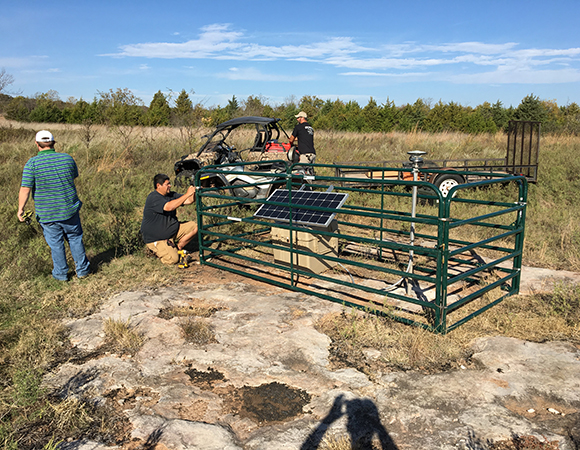 Brett Carpenter, University of Oklahoma (OU), and Jefferson Chang and Isaac Woelfel, Oklahoma Geological Survey (OGS), put the final touches on OK04. (Photo/Keith Williams, UNAVCO)