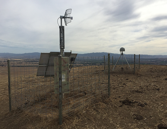 SW: P243 is the main uplink for the new Hollister network in the area around San Juan Bautista and Hollister, CA. It is in this area that the Calaveras-Hayward Fault splits off of the San Andreas Fault to run through the eastern San Francisco Bay Area. (Photo by Ryan Turner, UNAVCO)