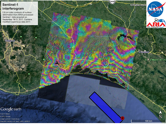 """Coseismic interferogram from the Chiapas earthquake generated by the ARIA system showing the """"wrapped"""" fringes (2.8 cm each). The data was acquired on 7 and 13 September 2017. The map includes the epicenter (star) and the preliminary USGS NEIC finite fault fault location estimate (blue rectangle).The system automatically processed the 6-day Copernicus Sentinel-1 interferograms from track 172 over the central part of the area affected by the earthquake in Oaxaca and Chiapas. Background image is from Google Earth. Contains modified Copernicus data 2017. For ARIA products, including a kmz of the interferogram, go to https://aria-share.jpl.nasa.gov/events/20170908-Oaxaca_Chiapas_Mexico_EQ/ (see link in Related Links). (Analyses and figure by the NASA JPL-Caltech ARIA team)"""