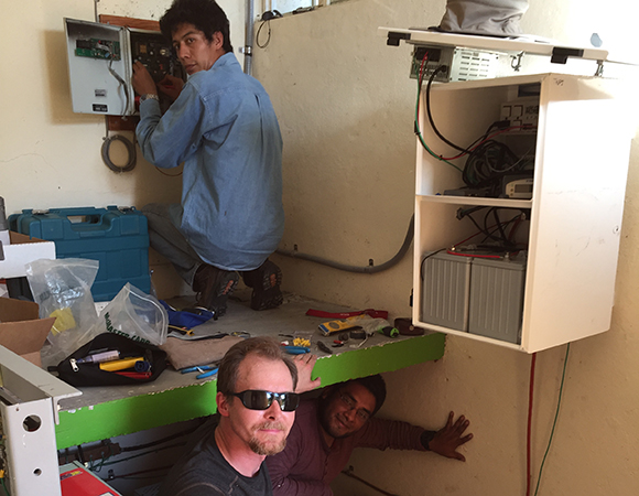 UNAVCO and UNAM staff working at TLALOCNET GPS-met station TNPJ on the SSN seismic bunker at Pijijiapan, Chiapas.