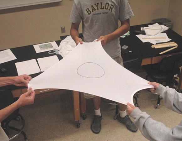 Students at Baylor University explore physical models of strain before embarking on infinitesimal strain analysis using GPS data. (Photo/Vince Cronin, Baylor University).