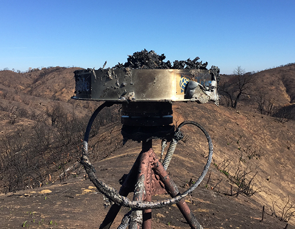 The GNSS antenna at P278 after the Chimney Fire, a bit worse for the wear. (Photo/PBO SW region, UNAVCO).