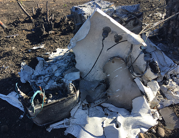 Partly melted, partly vaporized, the enclosure was in rough shape. (Photo/PBO SW region, UNAVCO)