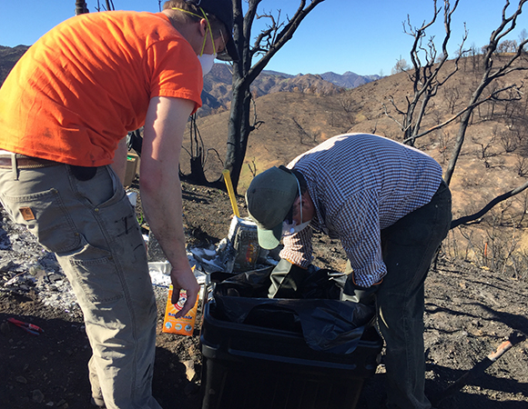 Project Manager Chris Walls and Field Engineer Shawn Lawrence pack the hazardous waste for safe transport and disposal. (Photo/PBO SW region, UNAVCO)