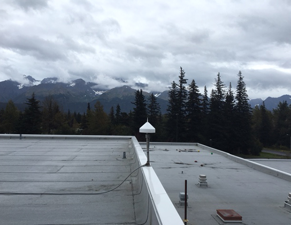 Mountains and humidity at the new CORS station installed by UNAVCO in Seward, Alaska. (Photo/John Sandru, UNAVCO)