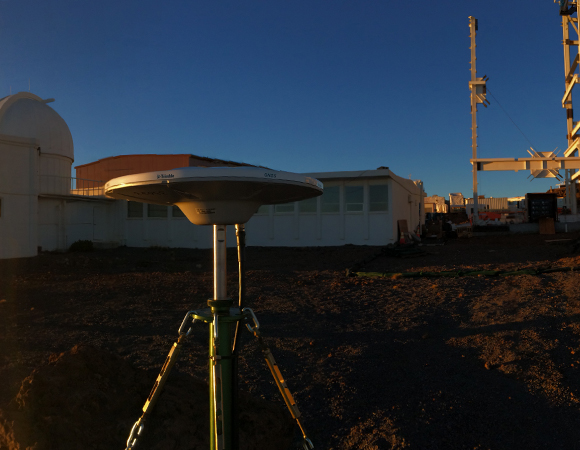 Pictured at the front of the photo is a semi-permanent GNSS antenna at the Haleakala Observatory on Maui that was installed during the first phase of UNAVCO's SGP fieldwork. The antenna was set up over a long-existing benchmark, and will remain standing indefinitely. Multiple antenna monuments on both Maui and Kauai help improve the site ties between the instruments of the two islands. In the far left-hand background is an existing SLR instrument. Pictured in the right-hand background is a partly constructed solar telescope (world's largest upon completion).