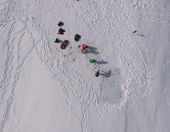 Researchers from CU Boulder and the Portland State University construct experimental cyroconite holes on the Canada Glacier in McMurdo Dry Valleys, Antarctica.  UAS surveys are use to produce high precision feature maps and construct surface models for identification of experimental controls.  Environmental sensors and in situ sampling provide additional information on the evolution of these isolated microbial communities. (Photo/Brendan Hodge, UNAVCO)