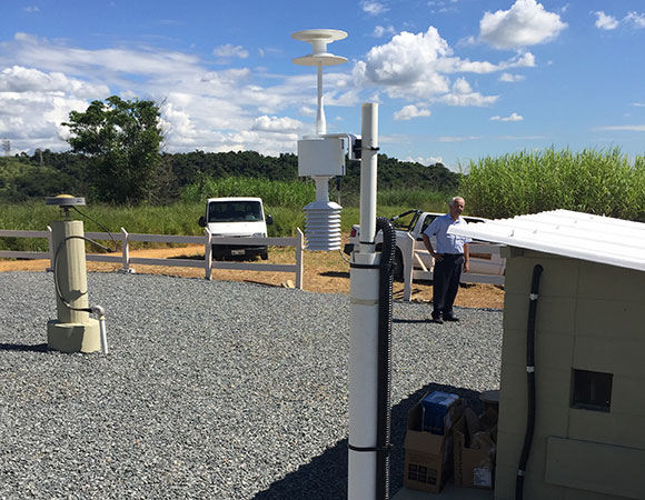 The meteorological device (foreground) is located close to the GNSS antenna (background).  The device measures pressure, temperature, and humidity.  These values are stored on a computer inside the station house, before they are pulled from the JPL data center. (Photo/Sarah Doelger)