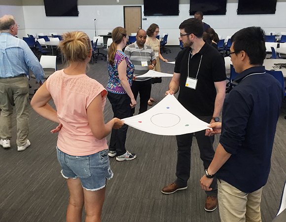Practicing hands-on learning tools for teaching geodesy in the GETSI workshop on Thursday, July 19. (Photo/Donna Charlevoix)