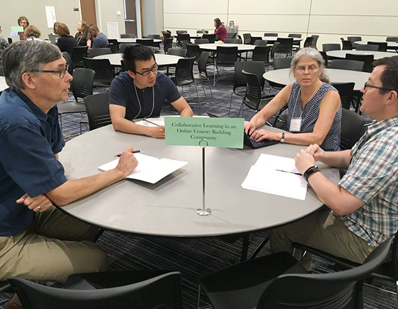 Laing Xue, center left, engages in the Collaborative Learning in an Online Course: Building Community round table. (Photo/NAGT)