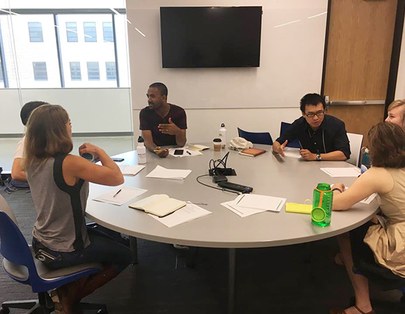 Tadesse Alemu, center left, and Laing Xue, center right, brainstorm ways to communicate about contentious topics in small groups at the science communication workshop. (Photo/NAGT)