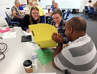 Esayas Gebremichael, far right, explores communication barriers in the science communication workshop on Thursday, July 19. (Photo/Beth Bartel)