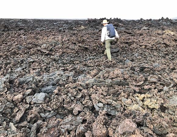Keith Williams traversing over the treacherous caldera floor of the Sierra Negra volcano on the way to cGPS stations GVO5, GV04 and GV02. (Photo/John Galetzka, UNAVCO)