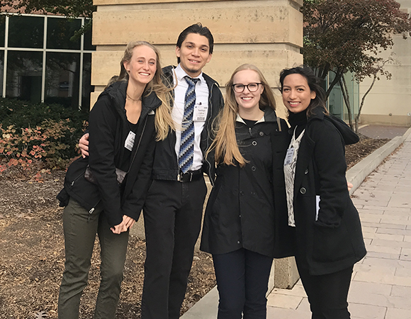 Geo-Launchpad interns pose in front of the Indiana Convention Center before presenting their posters at the GSA annual meeting in Indianapolis, IN. From left to right: Katie Gallagher, Santiago Cuevas, Grace Donovan, and Alex Hurtado. (Photo courtesy of UNAVCO)