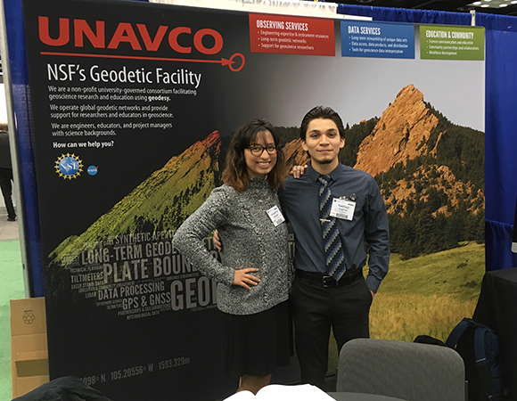 Alex Hurtado (left) and Santiago Cuevas (right) spend some time at the UNAVCO booth during the GSA annual meeting in Indianapolis, IN. (Photo courtesy of Patrick Shabram, Front Range Community College)