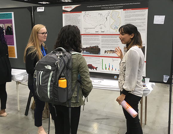 Grace Donovan (left) and Alex Hurtado (right) present their poster at the GSA annual meeting in Indianapolis, IN. (Photo courtesy of Patrick Shabram, Front Range Community College)