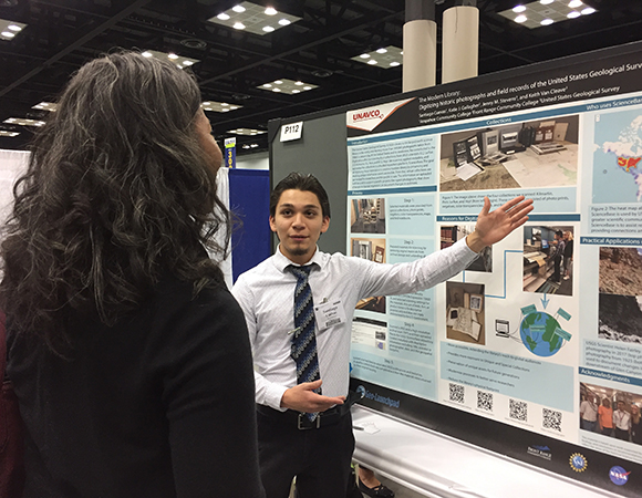 Santiago Cuevas and Katie Gallagher (not pictured) present their poster at the GSA annual meeting in Indianapolis, IN. (Photo by Donna Charlevoix, UNAVCO)