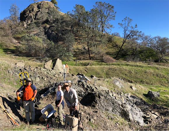 From the left: Noah Finnegan (UC Santa Cruz, PI), Colleen Murphy (UC Santa Cruz graduate student), and John Galetzka (UNAVCO) with cGPS site ORE3 in the background. (Photo/Dylan Schmeelk, UNAVCO)