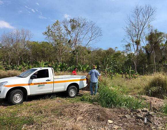 Gorki and Omar take a break after carrying equipment across a ditch for installation of station CN56 in Meteti. CN56 replaces the monumentation for CN34, which proved unstable. ANATI and IGNTG transported the team from Panama City to the site and back after helping with the installation. (Photo/Dylan Schmeelk, UNAVCO)