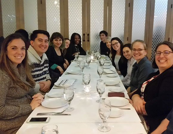UNAVCO interns and mentors, as well as intern alumni from other UNAVCO internship programs, pose at a reunion dinner while at the 2018 AGU Fall Meeting in Washington, D.C., where they spent the week presenting their research projects. From left to right: Kelsey Russo-Nixon, Joel Johnson, Teodora Mitroi, Beth Schaeffer, Aisha Morris, Sean Malloy (USIP), Haley May, Jessica Ghent (Geo-Launchpad), Adelicia Johnson, Emily Fairfax, Megan Brown, and Jordan Wachholtz. (Photo/Andria Ellis,UNAVCO).