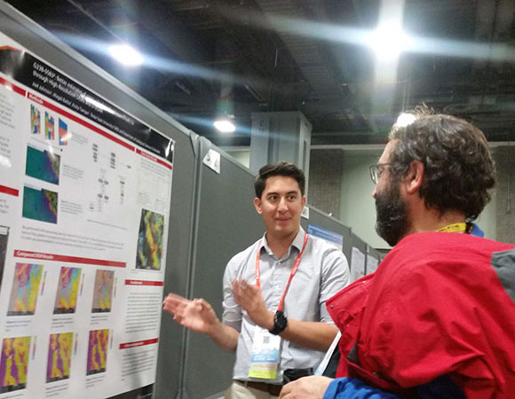 2018 RESESS intern Joel Johnson (left) explains his summer research in Turkish to an international scientist. (Photo/Andria Ellis, UNAVCO).