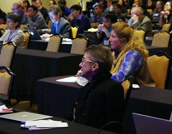 UNAVCO President Meghan Miller listens to a plenary presentation. (credit: D. Zietlow/UNAVCO)