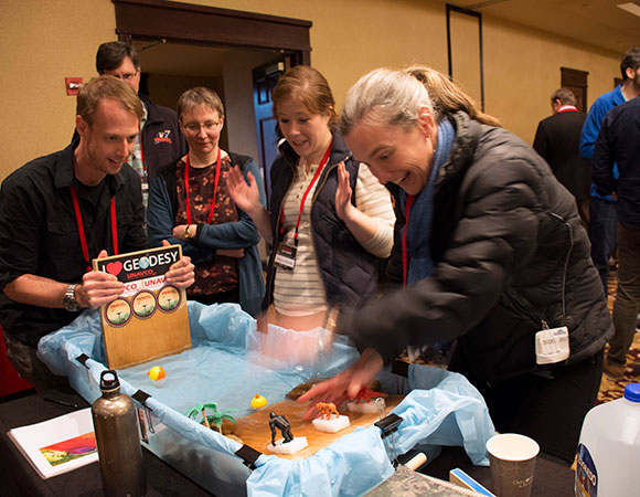 Workshop participants engage with hands-on demonstrations in the poster hall. (credit: S. Olds/UNAVCO)