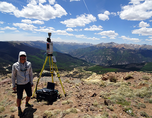 UNAVCO engineer Brendan Hodge operates the newest terrestrial laser scanner in the UNAVCO instrument pool, a Riegl VZ-6000, while on-site at the Slumgullion landslide, Gunnison National Forest, Colorado. The scan data is collected at the head scarp of the landslide to provide a good view of the active landslide surface below. (Photo/Mylène Jacquemart, CU-Boulder)