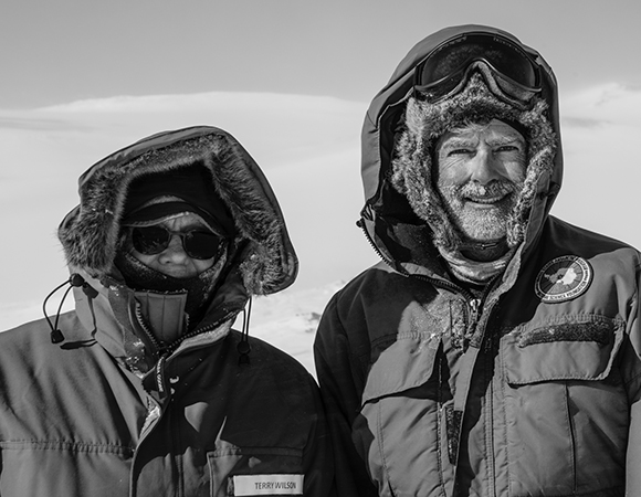 Dr. Terry Wilson and Dr. Eric Kendrick after installing the Mount Takahe GPS station (MTAK). (Photo/Nicolas Bayou, UNAVCO)