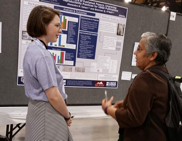 Shannon O'Neill talks about their poster during the GSA annual meeting in Phoenix, AZ. (Photo/Andi Ellis, UNAVCO)
