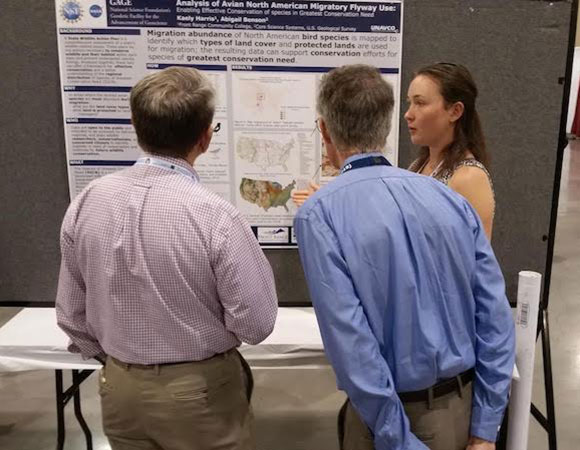 Kaely Harris talks about her poster during the GSA annual meeting in Phoenix, AZ. (Photo/Andi Ellis, UNAVCO)
